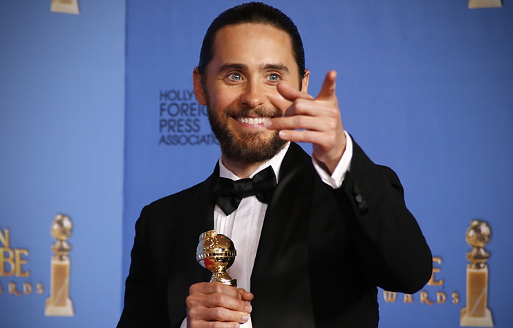 """Jared Leto poses backstage with his award for Best Supporting Actor in a Motion Picture for his role in """"The Dallas Buyers Club"""" at the 71st annual Golden Globe Awards in Beverly Hills"""